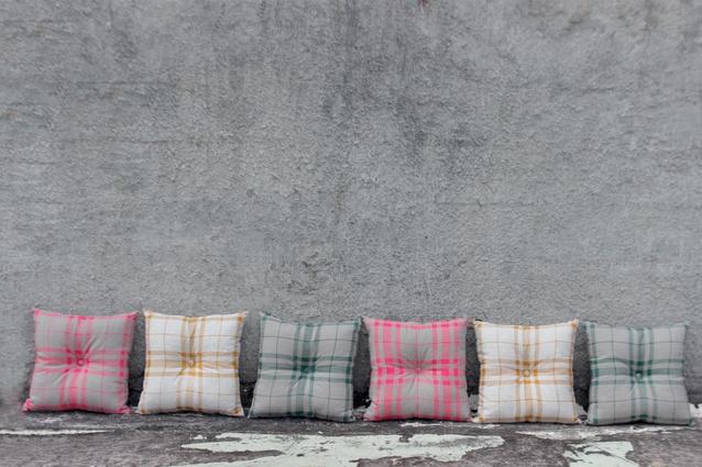 Cushions in 'McNab' tartan.