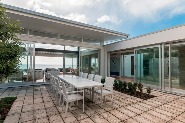 The enclosed courtyard allows for sheltered dining but still with access to the view.