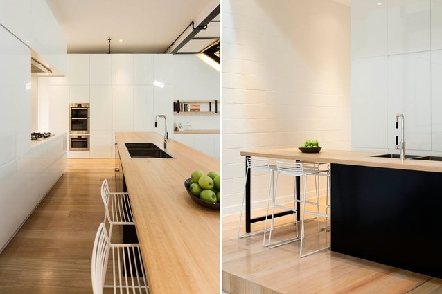 Pared-back materials and black-painted steelwork maintain an industrial feel in the apartment.