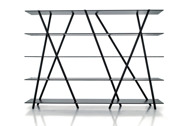 "The Chiku freestanding shelves, produced by Porro, are based on an initial concept involving a wood structure intersecting glass shelves, ""like a bamboo forest."""