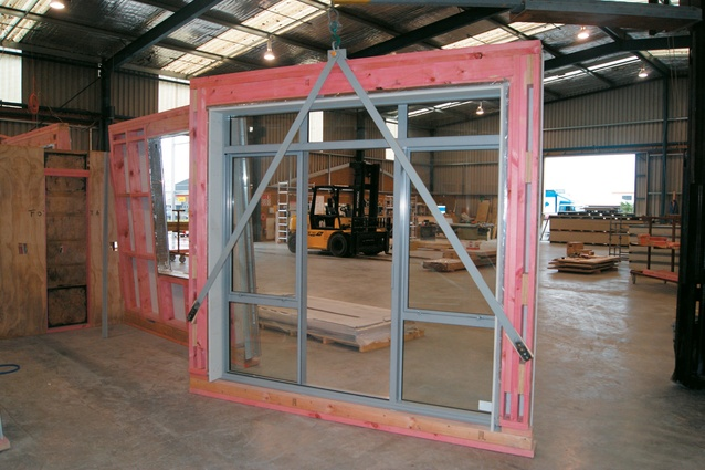 A completed frame with lifting equipment attached.