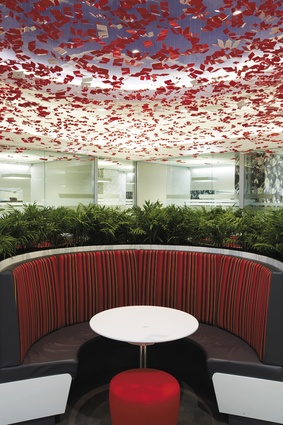 """Semicircular booth seating under a flock of floating """"W""""s."""