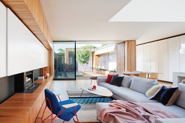 A central courtyard and a carefully placed light court extend internal spaces and provide cross views at Courtyard House.