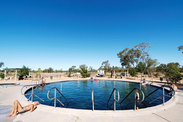 Visitors enjoying the Lightning Ridge hot artesian baths, northern New South Wales.