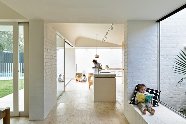 Lightly bagged and painted brickwork is seen throughout the home from the walls to the window seat and the kitchen's island bench.