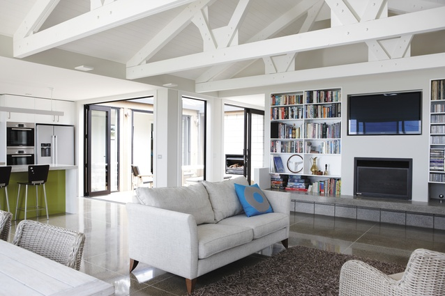 The open-plan kitchen and living room with large doors opening onto the internal courtyard.