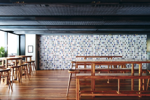 The dining room features a wall of custom-designed playing cards.