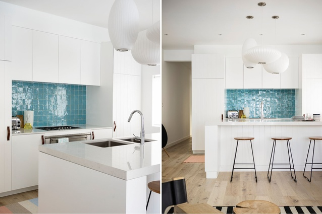 Bright pops of colour, like the tiled kitchen splashback, add punctuation to the soft grey and white tones.