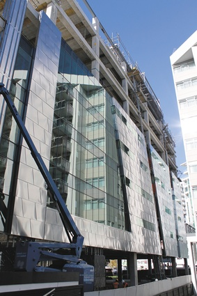 The west elevation curtainwall panels are clad with distressed stainless steel panels.