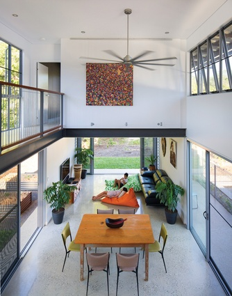 """All """"walls"""" in the living area are glass sliders or bifold doors that can be opened up to the outdoors. Artwork: Popo San Pascual."""