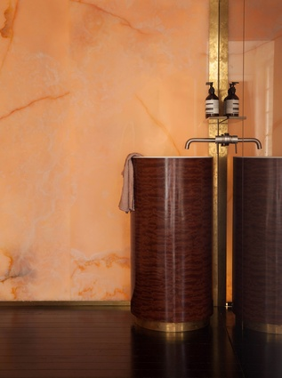 Custom vanity in sappale pomelli with aged brass base.