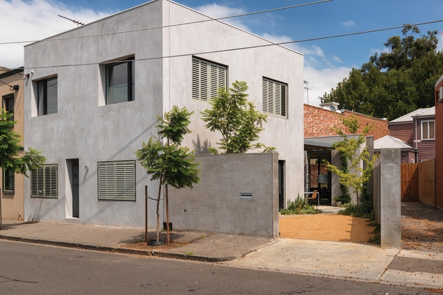The house presents a flattened facade to the street and the bare render coating lends it a Mediterranean feel.