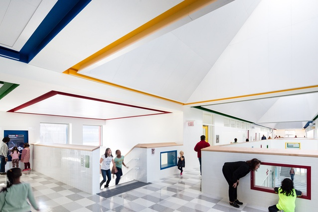 Kathleen Grimm School. Skylights and reflective ceiling panels reduce the need for artificial lighting, and solar hot water units further reduce energy use.