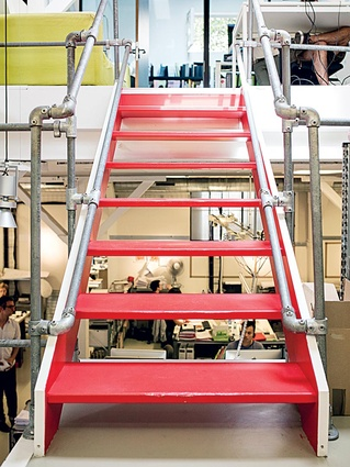 Red stairs lead up to the second level of the building.