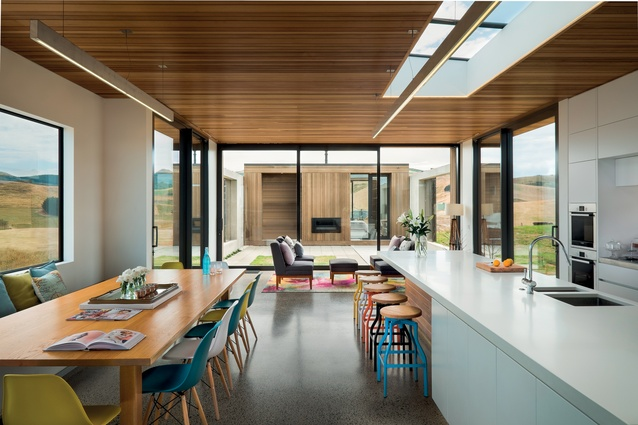 The kitchen and dining area can cater for large groups, serviced by a good-sized scullery at the back – to keep dirty pots and dishes from cluttering the clean white kitchen surfaces.