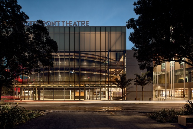 The frontage of the new ASB Waterfront Theatre in Wynyard Quarter sports opal glass and a curved container behind the glazing, giving the impression of a cylinder coiled in a tube.