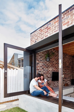 Large windows open to the lawn, a wide concrete windowsill/bench providing an ideal spot to relax.