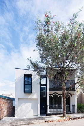 The simple and finely detailed addition is connected to an existing narrow terrace by a new entry door that conceals a sliver of enclosed space, six metres high.