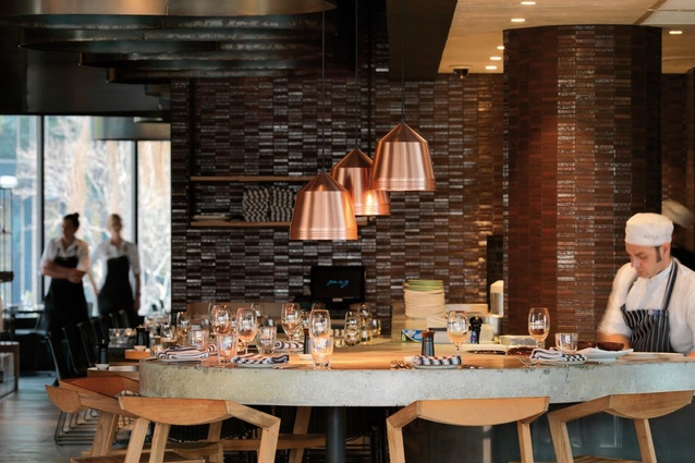 Bar seating allows for interaction with the chefs.