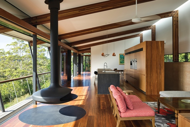 Long open spaces crowned by soaring beams and shaded by deep overhangs reference the farm sheds of an owner's heritage.
