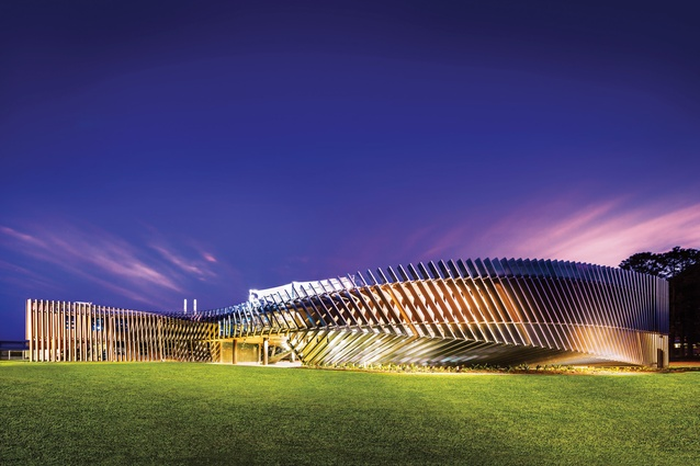 The steel channels and the bend in the building create a sense of dynamism.
