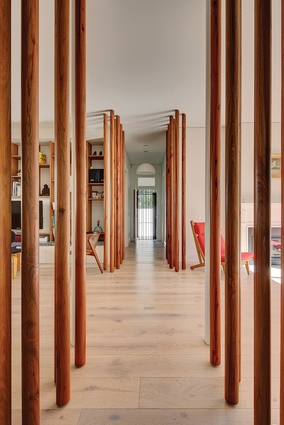 "The most striking feature of the interior is a series of narrow ""tree trunks"" that run down each side of the central hall."