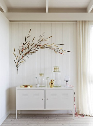 A cabinet from Ikea and a wall sculpture by Curtis Jere.