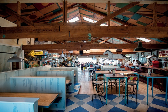 A large warehouse-like space above Petone Rowing Club is now a busy, visually engaging café. Floorboards have been reused as wall cladding.