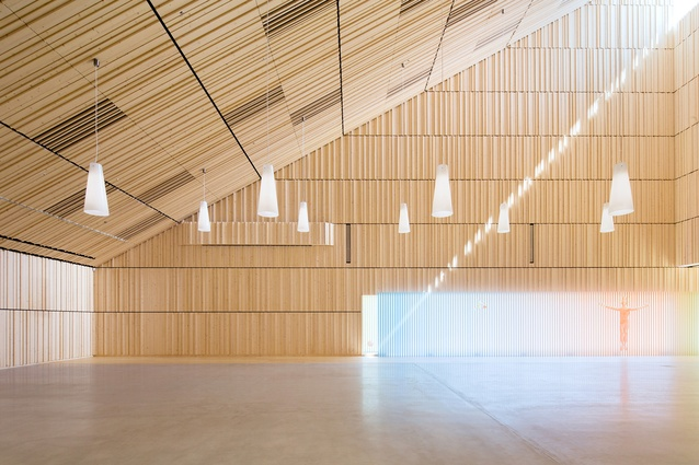 Suvela Chapel, Finland. A hybrid structure with wooden as well as concrete and steel elements. The interior is made of local spruce that creates a warm, welcoming atmosphere.