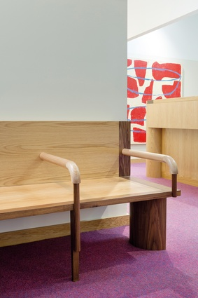 "The custom-made waiting lounge features ""fat and chunky"" legs as a counterpoint to the fine and tapered furniture legs elsewhere in the practice. Artwork: Peter Atkins."