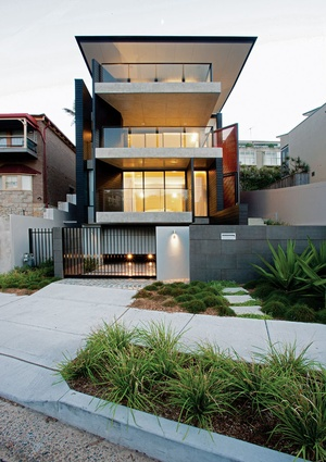 The exterior palette of black-stained jarrah, concrete and copper is continued indoors.