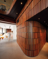 Faced With Vertical Timber Battens A Curving Wall Forms A