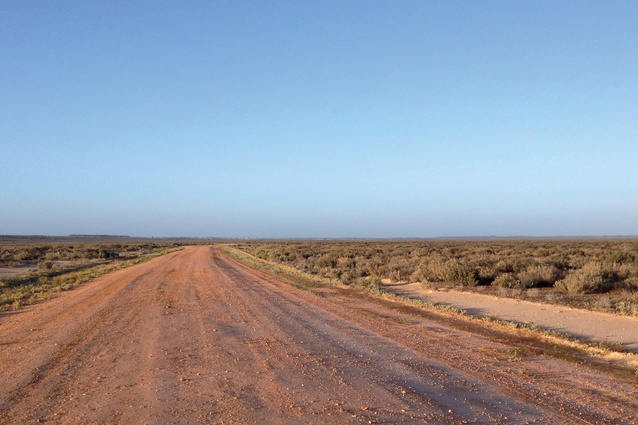 An expansive horizon stretches across the landscape of Mungo National Park, New South Wales.