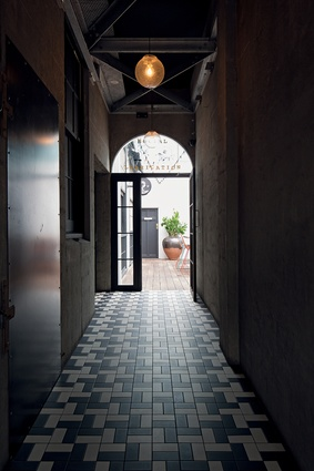 Corridor leading to the outdoor patio.