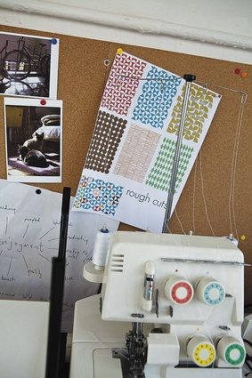 A sewing machine and inspiration board.