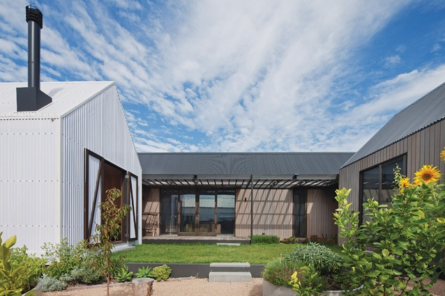 The house is broken down into smaller pavilions that create a private, north-facing courtyard.