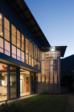 """Raw finishes and exposed structural elements are reminiscent of the """"utilitarian school buildings and halls of our childhood."""""""