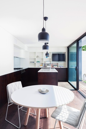 The modest height of the ground-floor kitchen makes it cosy.