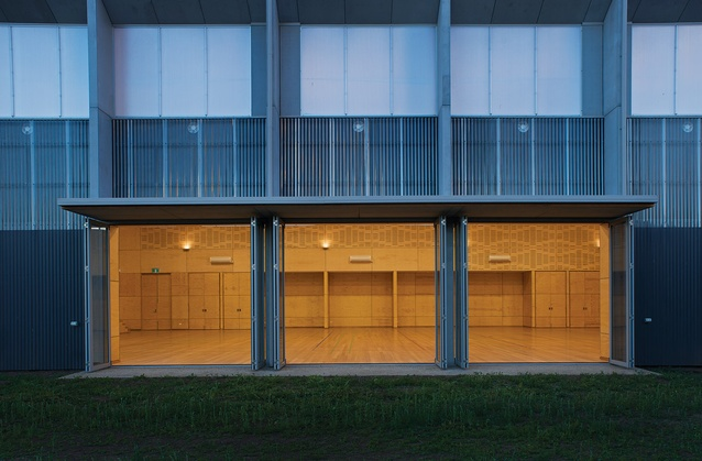 Large glazed doors open the multipurpose hall to the external courtyard.