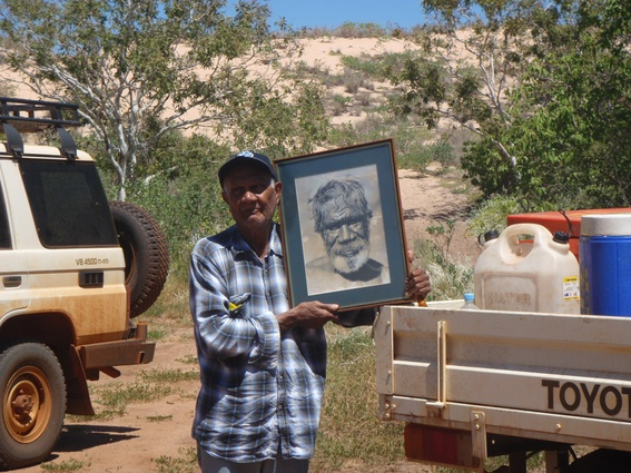 Frank Sebastian holding a photo of Friday Walmadany (Franks uncle) who was an important law man that lived at James Price Point area early 20th century.