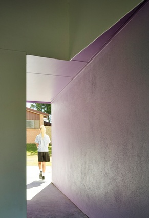 The use of colour selectively accentuates the origami-like folds of the apertures throughout the architecture.