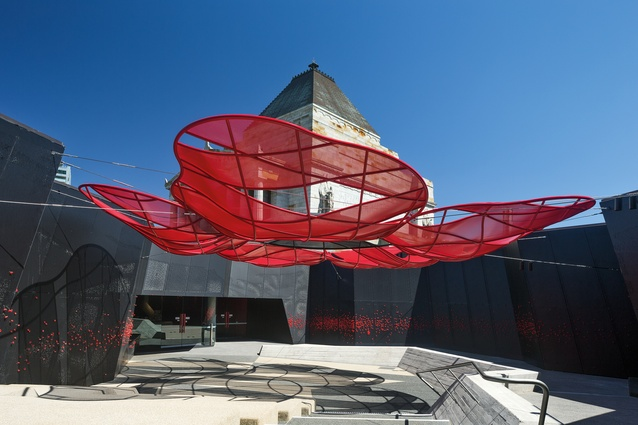 The steel and cloth poppy shaped canopy over the amphitheatre in the student entry courtyard.