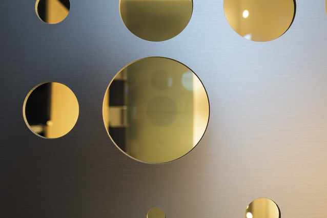 View through the perforated screens that separate areas of the fit-out, such as meeting rooms.