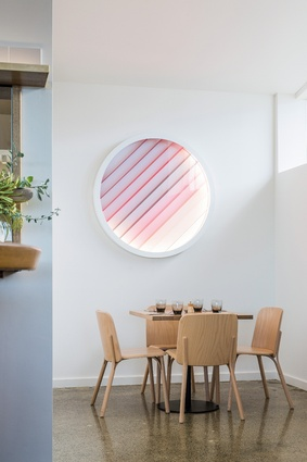 A custom-designed circular light box brings a bit of Boogie Nights to the interiors.
