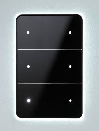 Antumbra light control panel by Philips Dynalite also in black glass; emits a welcoming glow in response to your presence.