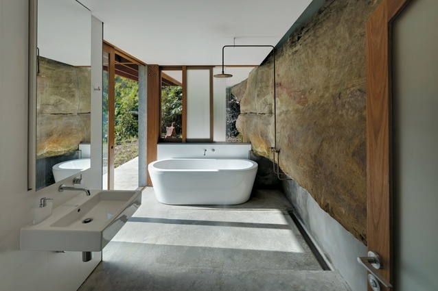 The cliff face actually comes into this bathroom in Cliff Face House by Fergus Scott Architects with Peter Stutchbury Architecture, from the Houses Awards.
