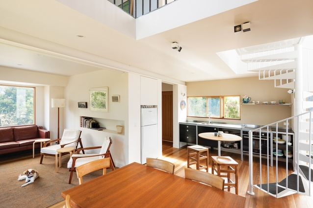 Airy, double-height volumes in the kitchen and living area lend this otherwise compact dwelling a sense of spaciousness.
