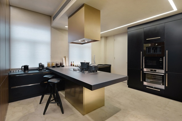 The kitchen and bedroom combine bronze and wood to create a muted, contemporary and traditionally luxe look.