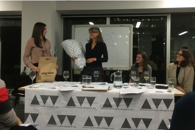 Julie Wilson gifts leaving flowers and present to Megan Rule on behalf of A+W•NZ at the AGM on 26 May.