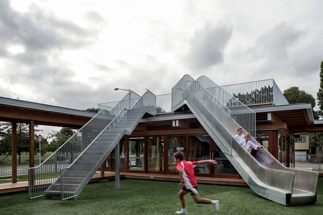 A roof deck on the corner pavilion looks out over the park and has a large slide on which to access the central courtyard. The rest of the building has been designed so that a roof deck can be added in the future if the school so desires.